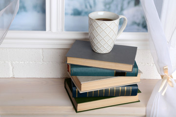 Composition of books and cup