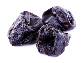 Three prunes isolated on white