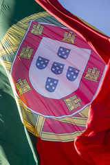 View of a huge portuguese flag flapping in the wind.
