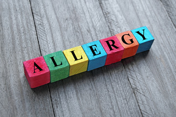 concept of allergy word on colorful wooden cubes