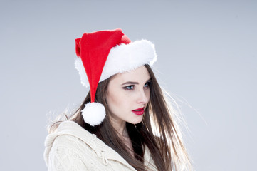 Christmas woman. Beautiful charming girl wearing santa hat.