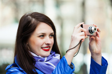 Smiling girl with photocamera