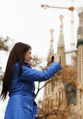Girl with digital camera photographing