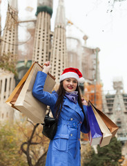 Woman with purchases against Sagrada familia
