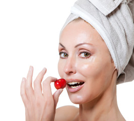 beautiful young woman in towel, with a cherry berry