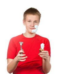 boy,teenager first time tries to have shave and is confused.