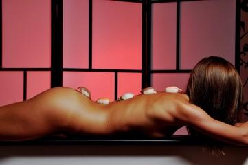 Young beautiful slim body woman with sushi rolls . Body sushi