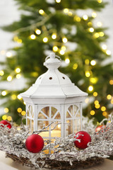 Christmas decorations with lantern and decorative wreath