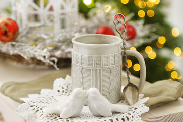 Mug with hot drink and Christmas decorations
