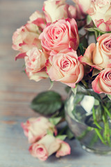 Bouquet of beautiful roses in vase