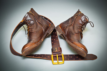 fashionable shoes handmade leather belt with a buckle, top view