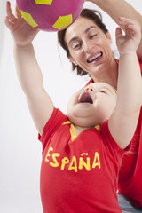 family spanish soccer fans playing
