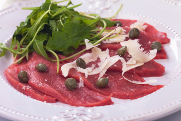 Beef carpaccio with parmesan and rocket salad