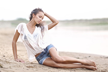 portrait of a beautiful young girl in wet shirt