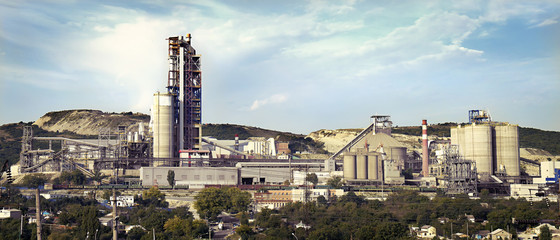 panorama of a cement plant in a sunny summer afternoon