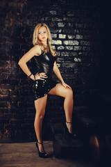 sexy woman on brick wall