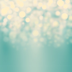 Festive blur background with natural bokeh and bright golden lig