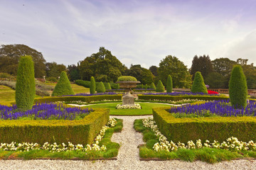 Landscaped garden with topiary at an historic English estate.