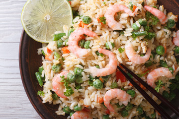 Asian fried rice with seafood macro, horizontal top view