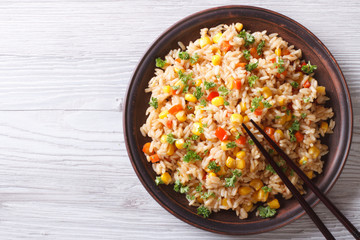 fried rice with eggs, corn and spice closeup horizontal top view