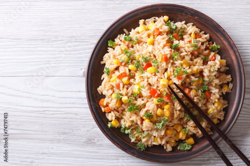 In de dag Voorgerecht fried rice with eggs, corn and spice closeup horizontal top view