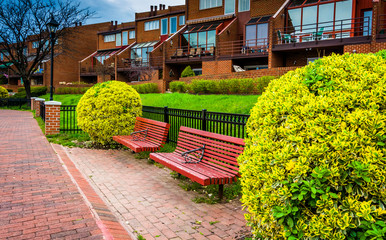 Benches and houses along the Waterfront Promenade in Canton, Bal