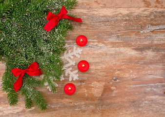 Christmas fir tree with decoration on a wooden