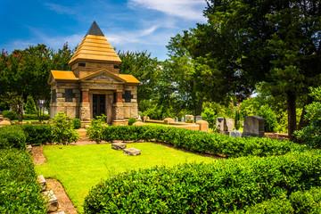 Bushes and mausoleum at Oakland Cemetary in Atlanta, Georgia.