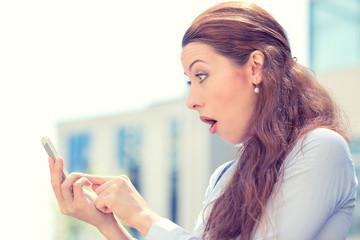 anxious young girl looking at phone seeing bad news photos