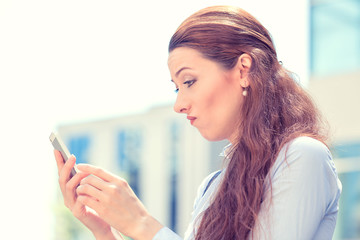 skeptical unhappy serious woman talking texting on phone