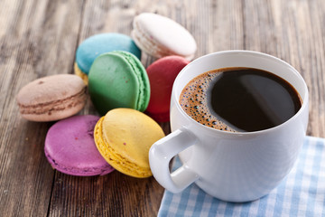 Cup of coffee and french macaron.