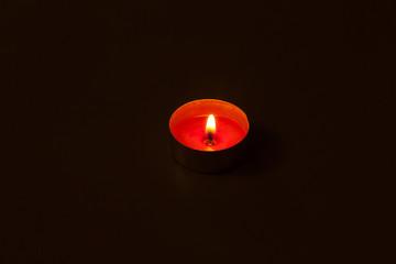 Alone candle in dark