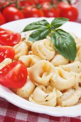 Tortellini pasta with tomato and basil