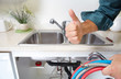Plumber on the kitchen. - 74802231