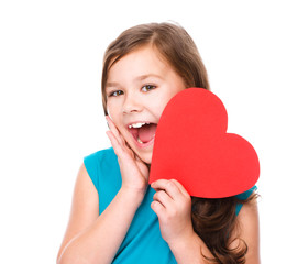 Happiness - smiling girl with red heart