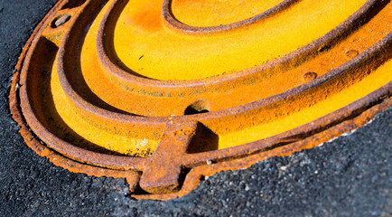 Rusty metal manhole cover