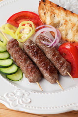 Kebab, meat skewer with fresh vegetable