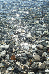 Gravel stones at the sea bottom.
