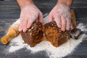 black bread in the hands of men
