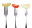 tomato, lime and apple on a fork