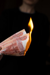 Person burns rubles
