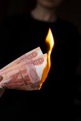 Person burns rubles