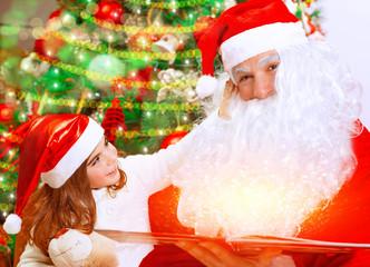 Cute little girl with Santa Claus