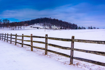 Fence and snow covered farm fields in rural Adam's County, Penns