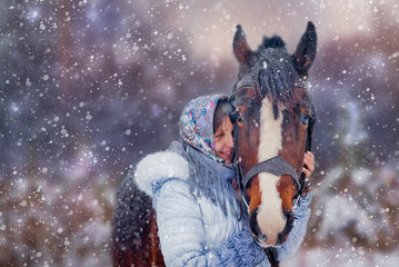 Friendship of Girl and horse in winter