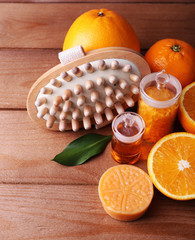Ripe orange with bottles of bath salt and essential oil, bar of