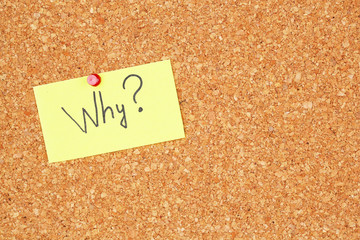 "Paper sheet with question ""Why"" on wooden background"