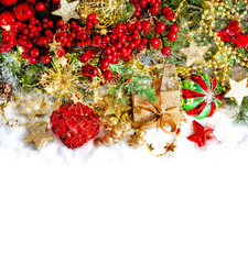christmas decoration with red baubles, golden ornaments and ligh