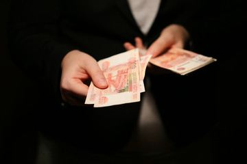 Close-up of a women hands counting Russian banknotes