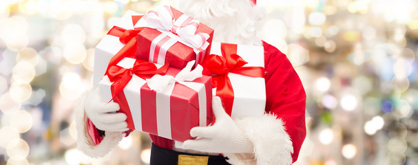 close up of santa claus with gift box